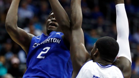 Creighton guard Khyri Thomas, left, goes up for a shot against Seton Hall forward Angel Delgado during the first half of an NCAA college basketball game, Wednesday, Feb. 15, 2017, in Newark, N.J. (AP Photo/Julio Cortez)