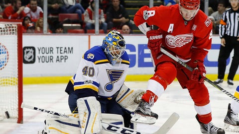 Detroit Red Wings left wing Justin Abdelkader (8) screens a shot on St. Louis Blues goalie Carter Hutton (40) in the second period of an NHL hockey game, Wednesday, Feb. 15, 2017, in Detroit. (AP Photo/Paul Sancya)