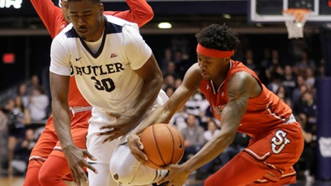 St. John's Shamorie Ponds, right, steals the basketball from Butler's Kelan Martin during the first half of an NCAA college basketball game Wednesday, Feb. 15, 2017, in Indianapolis. (AP Photo/Darron Cummings)