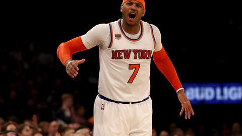 NEW YORK, NY - FEBRUARY 12:  Carmelo Anthony #7 of the New York Knicks reacts after he is called for a foul in the fourth quarter against the San Antonio Spurs at Madison Square Garden on February 12, 2017 in New York City. NOTE TO USER: User expressly acknowledges and agrees that, by downloading and or using this Photograph, user is consenting to the terms and conditions of the Getty Images License Agreement  (Photo by Elsa/Getty Images)