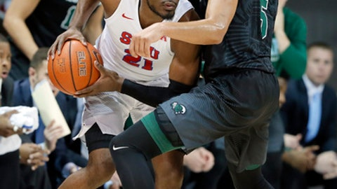 SMU guard Ben Emelogu II (21) works against Tulane's Cameron Reynolds (5) in the first half of an NCAA college basketball game, Wednesday, Feb. 15, 2017, in Dallas. (AP Photo/Tony Gutierrez)