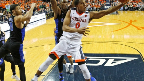 Virginia guard Devon Hall (0) takes a shot in front of Duke forward Harry Giles, center, and forward Jayson Tatum (0) during the first half of an NCAA college basketball game in Charlottesville, Va., Wednesday, Feb. 15, 2017. (AP Photo/Steve Helber)