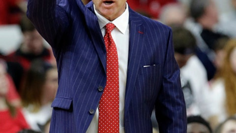 North Carolina State coach Mark Gottfried directs his team during the first half of an NCAA college basketball game in Raleigh, N.C., Wednesday, Feb. 15, 2017. North Carolina won 97-73. (AP Photo/Gerry Broome)