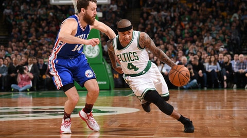 BOSTON, MA - FEBRUARY 15:  Isaiah Thomas #4 of the Boston Celtics drives to the basket against Sergio Rodriguez #14 of the Philadelphia 76ers during a game on February 15, 2017 at TD Garden in Boston, Massachusetts. NOTE TO USER: User expressly acknowledges and agrees that, by downloading and/or using this photograph, user is consenting to the terms and conditions of the Getty Images License Agreement. Mandatory Copyright Notice: Copyright 2017 NBAE (Photo by Brian Babineau/NBAE via Getty Images)