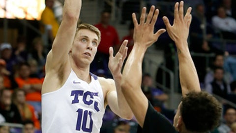 TCU Horned Frogs forward Vladimir Brodziansky (10) shoots over Oklahoma State Cowboys guard Jeffrey Carroll (30) in the first half of an NCAA college basketball game in Fort Worth, Texas on Wednesday, Feb. 15, 2017. (Brad Loper/Star-Telegram via AP)