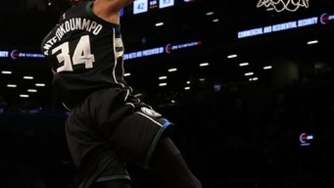 NEW YORK, NY - FEBRUARY 15: Giannis Antetokounmpo #34 of the Milwaukee Bucks hits a basket against the Brooklyn Nets at Barclays Center on February 15, 2017 in Brooklyn borough of New York City. NOTE TO USER: User expressly acknowledges and agrees that, by downloading and or using this photograph, User is consenting to the terms and conditions of the Getty Images License Agreement.  (Photo by Mike Stobe/Getty Images)