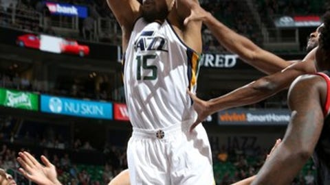 SALT LAKE CITY, UT - FEBRUARY 15: Derrick Favors #15 of the Utah Jazz dunks against the Portland Trail Blazers on February 15, 2017 at vivint.SmartHome Arena in Salt Lake City, Utah. NOTE TO USER: User expressly acknowledges and agrees that, by downloading and or using this Photograph, User is consenting to the terms and conditions of the Getty Images License Agreement. Mandatory Copyright Notice: Copyright 2017 NBAE (Photo by Melissa Majchrzak/NBAE via Getty Images)