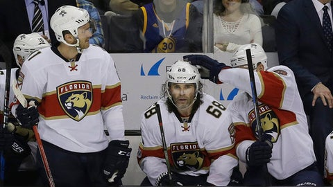 Florida Panthers right wing Jaromir Jagr (68), from the Czech Republic, is congratulated by Colton Sceviour, right, after Jagr's 1,900th career point on an assist on Aleksander Barkov's goal during the third period of an NHL hockey game against the San Jose Sharks in San Jose, Calif., Wednesday, Feb. 15, 2017. The Panthers won 6-5 in overtime. (AP Photo/Jeff Chiu)