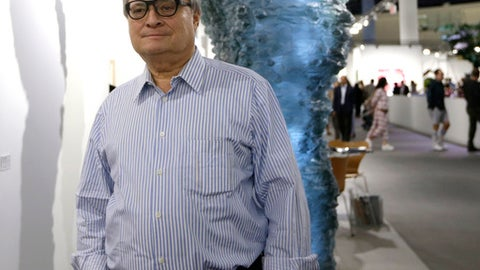 """FILE - In this Nov. 30, 2016, file photo, Miami Marlins owner Jeffrey Loria stands a hallway during the VIP opening of Art Basel at the Miami Beach Convention Center,  in Miami Beach, Fla. The Kushner family, which has close ties to the White House, put the brakes on its negotiations to buy the Miami Marlins because of a report team owner Jeffrey Loria may be nominated by President Trump to become ambassador to France. Joshua Kushner, whose older brother is an adviser to the president, has a preliminary agreement to buy the Marlins. But in a statement released late Wednesday by Kushner's brother-in-law, Joseph Meyer, the family expressed concern the sale might """"complicate"""" the ambassadorship appointment. (AP Photo/Alan Diaz, File)"""