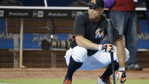 FILE - In this Sept. 6, 2016, file photo, Miami Marlins' Giancarlo Stanton watches batting practice before a baseball game against the Philadelphia Phillies, in Miami. For slugger Giancarlo Stanton and his Marlins teammates, it won't be that difficult for 2017 to be better than 2016. (AP Photo/Lynne Sladky, File)