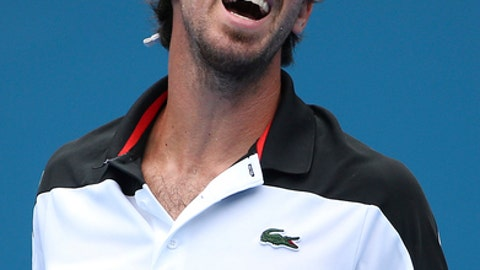 Pablo Cuevas of Uruguay grimaces after missing a shot to Gilles Muller of Luxembourg during their men's quarterfinal singles match at the Sydney International tennis tournament in Sydney Thursday, Jan. 12, 2017. (AP Photo/Rick Rycroft)
