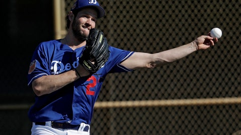 Los Angeles Dodgers' Clayton Kershaw throws a ball during a spring training baseball workout Tuesday, Feb. 14, 2017, in Glendale, Ariz. (AP Photo/Morry Gash)