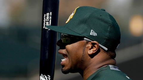 Oakland Athletics center fielder Rajai Davis smiles during spring baseball practice in Mesa, Ariz., Thursday, Feb. 16, 2017. (AP Photo/Chris Carlson)