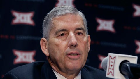 FILE - In this Oct. 17, 2016, file photo, Big 12 Commissioner Bob Bowlsby speaks to reporters after The Big 12 Conference meeting in Grapevine, Texas. The head of the NCAA's football oversight committee and the leader of the American Football Coaches Association are against delaying until the end of next season the expansion of FBS coaching staffs to 10 members. Bowlsby, chairman of the oversight committee, and Todd Berry, executive director of the AFCA, acknowledged hiring when staffs are typically set could inconvenience some schools. Still, they say it is not worth waiting.(AP Photo/LM Otero, File)