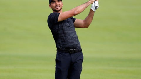 Jason Day, of Australia, follows his shot on the fairway of the second hole during the first round of the Genesis Open golf tournament at Riviera Country Club Thursday, Feb. 16, 2017, in the Pacific Palisades area of Los Angeles. (AP Photo/Ryan Kang)