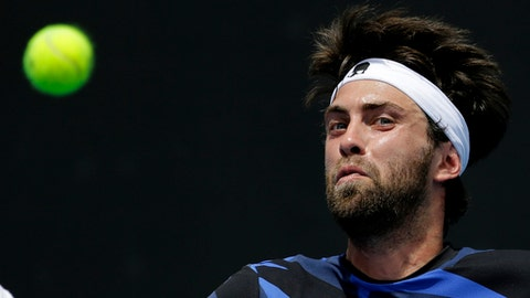 Georgia's Nikoloz Basilashvili eyes on a ball to return to Germany's Philipp Kohlschreiber during their first round match at the Australian Open tennis championships in Melbourne, Australia, Tuesday, Jan. 17, 2017. (AP Photo/Aaron Favila)