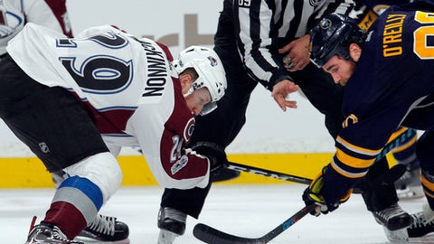 Buffalo Sabres' Ryan O'Reilly (90) and Colorado Avalanche's Nathan Mackinnon (29) take the draw during the second period of an NHL hockey game, Thursday, Feb. 16, 2017, in Buffalo, N.Y. (AP Photo/Jeffrey T. Barnes)