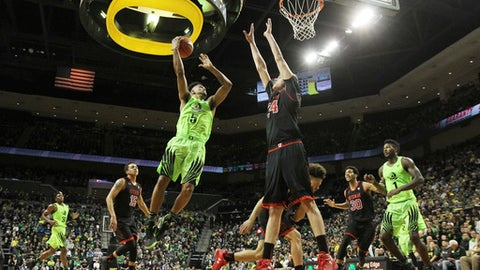 Oregon's Tyler Dorsey, center left, goes to the basket against Utah's Jayce Johnson during the first half of an NCAA college basketball game Thursday, Feb. 16, 2017, in Eugene, Ore. (AP Photo/Chris Pietsch)