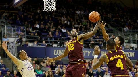Arizona State forward Andre Adams (12) grabs a rebound during the first half of the team's NCAA college basketball game against Washington, Thursday, Feb. 16, 2017, in Seattle. (AP Photo/Ted S. Warren)