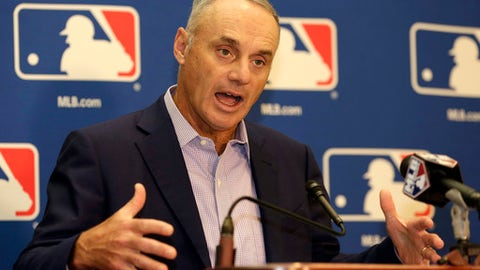 FILE - In this Feb. 3, 2017, file photo, Major League Baseball Commissioner Rob Manfred speaks during a news conference following a meeting with team owners in Palm Beach, Fla. Manfred says he can't offer a prediction on how likely it is that baseball will be altering the strike zone this season. Manfred discussed that and other potential rule changes Thursday, Feb. 16, 2017, at the Detroit Tigers' spring training complex, which was hosting a Grapefruit League media day.  (AP Photo/Lynne Sladky, File)