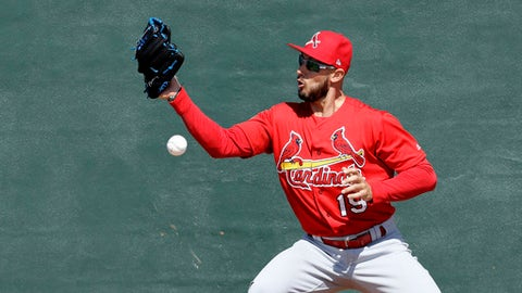 St. Louis Cardinals' Jordan Schafer tries to catch a ball as part of a drill during a spring training baseball workout Friday, Feb. 17, 2017, in Jupiter, Fla. (AP Photo/David J. Phillip)