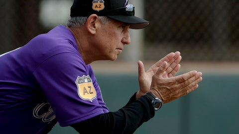 Colorado Rockies manager Bud Black claps during spring baseball practice in Scottsdale, Ariz., Friday, Feb. 17, 2017. (AP Photo/Chris Carlson)