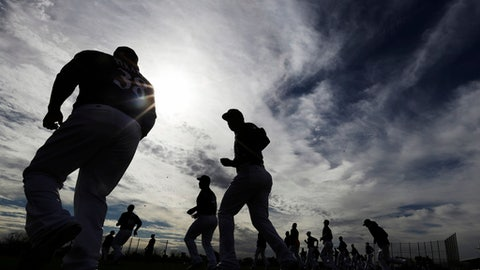 Milwaukee Brewers players run during a spring training baseball workout Tuesday, Feb. 14, 2017, in Phoenix. (AP Photo/Morry Gash)