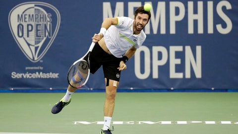 Mikhail Kukushkin, of Kazakhstan, returns a shot to Steve Johnson in a quarterfinal at the Memphis Open tennis tournament Friday, Feb. 17, 2017, in Memphis, Tenn. (AP Photo/Mark Humphrey)