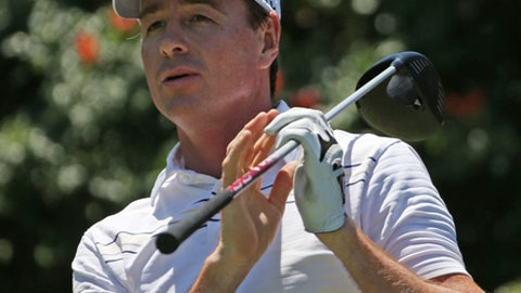 Australia's Brett Rumford watches his drive on the 6th tee during the third round of the Australian Open Golf championship in Sydney, Saturday, Nov. 29, 2014. (AP Photo/Rick Rycroft)