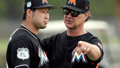 Miami Marlins manager Don Mattingly, right, talks with pitcher Junichi Tazawa during a spring training baseball workout Saturday, Feb. 18, 2017, in Jupiter, Fla. (AP Photo/David J. Phillip)