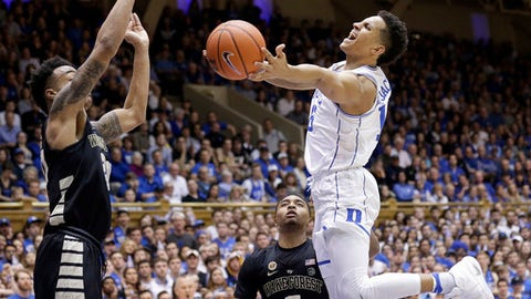 Duke's Frank Jackson drives to the basket while Wake Forest's Brandon Childress (0) and John Collins, left, defend during the second half of an NCAA college basketball game in Durham, N.C., Saturday, Feb. 18, 2017. Duke won 99-94. (AP Photo/Gerry Broome)