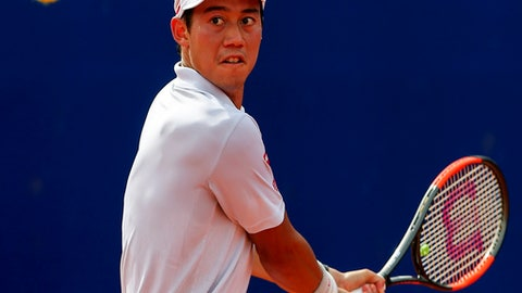 Kei Nishikori of Japan eyes the ball during a tennis match at the ATP Argentina Open against Carlos Berlocq, in Buenos Aires, Argentina, Saturday, Feb. 18, 2017. (AP Photo/Agustin Marcarian)