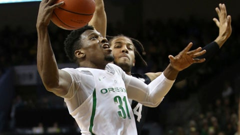 Oregon's Dylan Ennis, left, goes to the basket against Colorado's Josh Fortune during the first half of an NCAA college basketball game Saturday, Feb. 18, 2017, in Eugene, Ore. (AP Photo/Chris Pietsch)