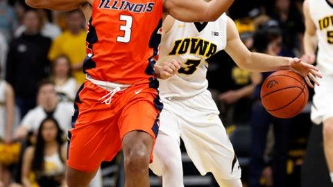 Iowa guard Jordan Bohannon, right, is fouled by Illinois guard Te'Jon Lucas during the second half of an NCAA college basketball game, Saturday, Feb. 18, 2017, in Iowa City, Iowa. Illinois won 70-66. (AP Photo/Charlie Neibergall)