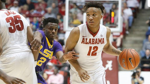 LSU guard Antonio Blakeney (2) fights through a pick to keep up with Alabama guard Dazon Ingram (12) in Coleman Coliseum in Tuscaloosa, Ala., Saturday, Feb. 18, 2027. Alabama defeated LSU 90-72. (Gary Cosby Jr.,/The Tuscaloosa News via AP)