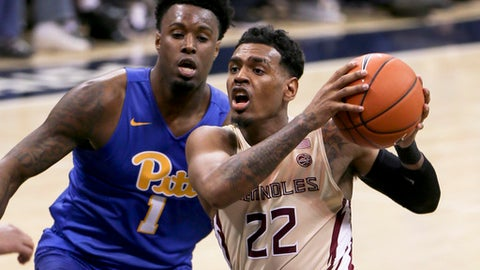 Florida State's Xavier Rathan-Mayes (22) drives to the hoop as Pittsburgh's Jamel Artis (1) defends during the second half of an NCAA college basketball game, Saturday, Feb. 18, 2017, in Pittsburgh. (AP Photo/Keith Srakocic)