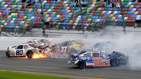 Caesar Barcarella (80), Gus Dean (32), AJ Fike, back left, David LeBeau (37) and John Ferrier, back right, crash on the front stretch during an ARCA auto race at Daytona International Speedway, Saturday, Feb. 18, 2017, in Daytona Beach, Fla. (AP Photo/Terry Renna)