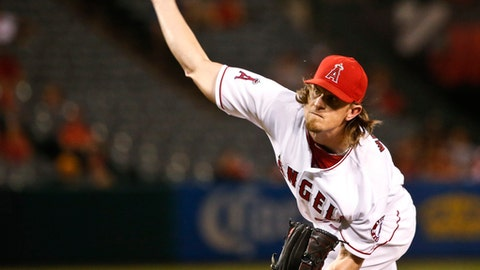 FILE - In this Sept. 26, 2016, file photo, Los Angeles Angels starting pitcher Jered Weaver works against the Oakland Athletics during the first inning of baseball game in Anaheim, Calif. Weaver has agreed to join the San Diego Padres after 11 seasons with the Los Angeles Angels. (AP Photo/Lenny Ignelzi, File)