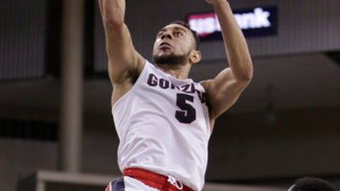 Gonzaga guard Nigel Williams-Goss (5) shoots against Pacific guard Maleke Haynes (0) during the second half of an NCAA college basketball game in Spokane, Wash., Saturday, Feb. 18, 2017. (AP Photo/Young Kwak)