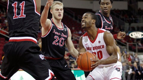New Mexico's Sam Logwood goes in for a shot against Fresno State's Sam Bittner in the first half of an NCAA college basketball game in Fresno, Calif., Saturday, Feb. 18, 2017. (AP Photo/Gary Kazanjian)