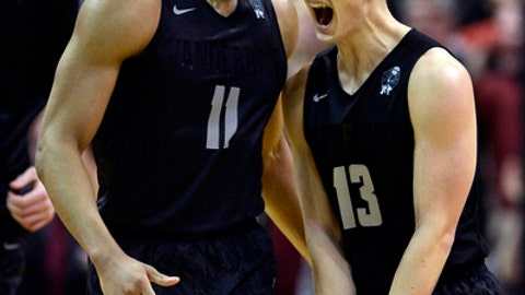 Vanderbilt guard Riley LaChance (13) celebrates with forward Jeff Roberson (11) after LaChance made a 3-point basket against South Carolina in the second half of an NCAA college basketball game Saturday, Feb. 18, 2017, in Nashville, Tenn. Vanderbilt won 71-62. (AP Photo/Mark Zaleski)