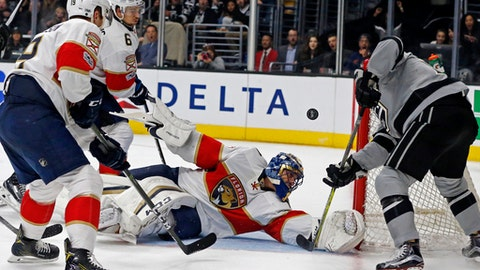 Florida Panthers goalie Roberto Luongo (1) blocks a shot by the Los Angeles Kings during the second period of an NHL hockey game in Los Angeles on Saturday, Feb. 18, 2017. (AP Photo/Reed Saxon)