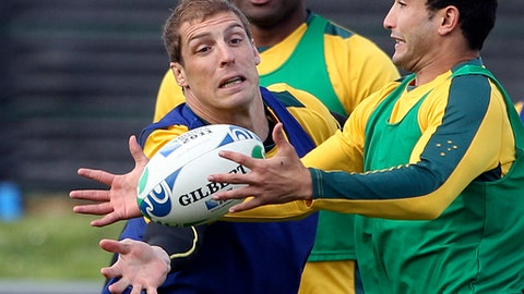 FILE - In this Sept. 13, 2011 file photo, Australia rugby players Dan Vickerman, left, and Anthony Fainga'a, right, compete for the ball during a team training session in Auckland, New Zealand. Vickerman, who played 63 rugby tests for Australia, has died at his home in Sydney. He was 37. The Australian Rugby Union issued a statement Sunday, Feb. 19, 2017, saying players and officials were shocked and deeply saddened by the sudden the death of the former Wallabies lock. (AP Photo/Rob Griffith, File)