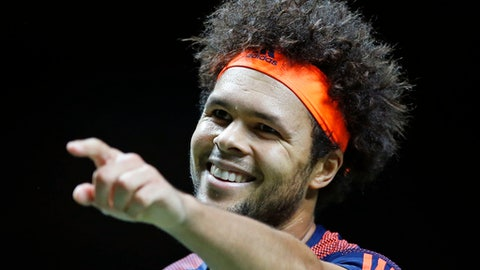France's Jo-Wilfried Tsonga celebrates winning his match against Belgium's David Goffin in three sets, 4-6, 6-4, 6-1, in the men's singles final of the ABN AMRO world tennis tournament at the Ahoy stadium in Rotterdam, Netherlands, Sunday, Feb. 19, 2017. (AP Photo/Peter Dejong)