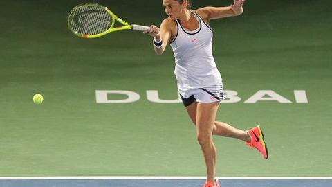 Roberta Vinci of Italy returns the ball to Kristyna Pliskova of Czech Republic during the Dubai Tennis Championships in Dubai, United Arab Emirates, Sunday, Feb. 19, 2017. (AP Photo/Kamran Jebreili)