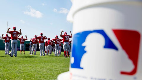 Boston Red Sox players warm up during a spring training baseball workout in Fort Myers, Fla., Sunday, Feb. 19, 2017. (AP Photo/David Goldman)
