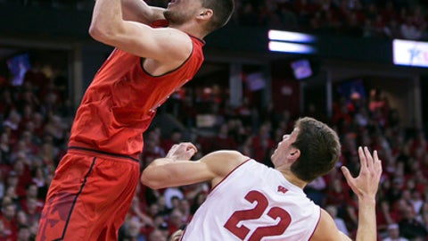 Maryland's Michal Cekovsky (15) misses a pass against Wisconsin's Ethan Happ (22) during the first half of an NCAA college basketball game Sunday, Feb. 19, 2017, in Madison, Wis. (AP Photo/Andy Manis)
