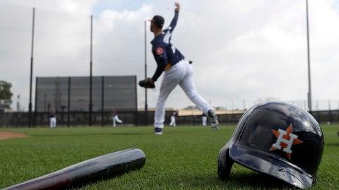 Houston Astros third baseman Yuli Gurriel throws during a spring training baseball workout Sunday, Feb. 19, 2017, in West Palm Beach, Fla. (AP Photo/David J. Phillip)
