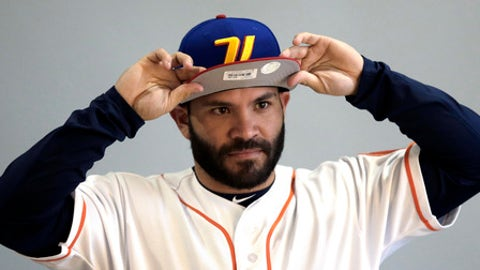 Houston Astros second baseman Jose Altuve adjusts a Venezuelan team cap while being photographed before a spring training baseball workout Sunday, Feb. 19, 2017, in West Palm Beach, Fla. (AP Photo/David J. Phillip)