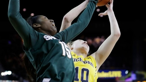 Michigan State forward Victoria Gaines (15) knocks the ball away from Michigan guard Nicole Munger (10) during the second half of an NCAA college basketball game, Sunday, Feb. 19, 2017, in Ann Arbor, Mich. (AP Photo/Carlos Osorio)